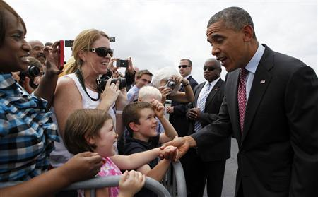 U.S. President Barack Obama shakes hands after arriving at North Carolina Air National Guard base in Charlotte, September 5, 2012. REUTERS/Larry Downing