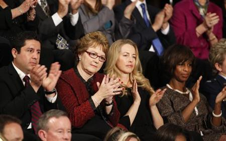 Attorney Juan Jose Redin (L), Debbie Bosanek, Laurene Powell Jobs and Alicia Boler- Davis sit in First Lady Michelle Obama's box in Washington, January 24, 2012. REUTERS/Larry Downing/Files