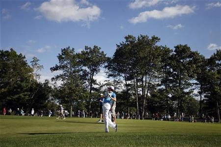 Rory McIlroy of Northern Ireland hits from the 15th fairway during the final round of the Deutsche Bank Championship golf tournament in Norton, Massachusetts September 3, 2012. REUTERS/Dominick Reuter