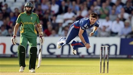 England's James Anderson bowls as South Africa's Hashim Amla (L) looks on during the fifth one-day international cricket match at Trent Bridge cricket ground in Nottingham September 5, 2012. REUTERS/Philip Brown