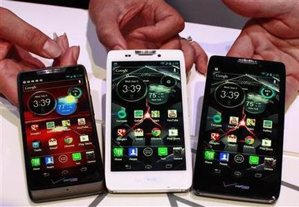 Product specialists display new Motorola droid phones; (L-R) Droid Razor M, Droid Razor HD and the Droid Razor Maxx HD during a launch event in New York, September 5, 2012. REUTERS/Brendan McDermid