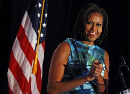 REFILE - ADDING BYLINE U.S. first lady Michelle Obama acknowledges the applause as she arrives to speak at the Human Rights Campaign Luncheon in Charlotte, North Carolina, September 5, 2012. REUTERS/Jim Young