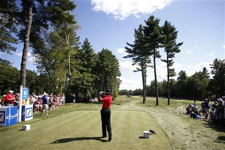 Tiger Woods of the U.S. tees off at the sixth hole during the final round of the Deutsche Bank Championship golf tournament in Norton, Massachusetts September 3, 2012. REUTERS/Dominick Reuter