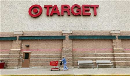 A Target shopper pushes her card outside a store in Falls Church, Virginia May 14, 2012. Target Corp. (TGT) will report its first quarter results on May 16th. REUTERS/Kevin Lamarque