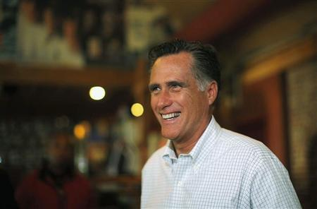 Republican presidential candidate and former Massachusetts Governor Mitt Romney talks briefly with reporters after stopping to buy two pizzas at Lui-Lui restaurant in West Lebanon, New Hampshire September 5, 2012. REUTERS/Brian Snyder