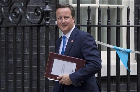 Britian's Prime Minister David Cameron arrives at 10 Downing Street in London September 5, 2012. REUTERS/Neil Hall
