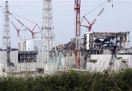 (From L to R) The No. 1, the No. 2, the No. 3 and the No. 4 reactor buildings are seen at the Tokyo Electric Power Co's (TEPCO) tsunami-crippled Fukushima Daiichi nuclear power plant in Fukushima prefecture May 26, 2012. REUTERS/Tomohiro Ohsumi/Pool