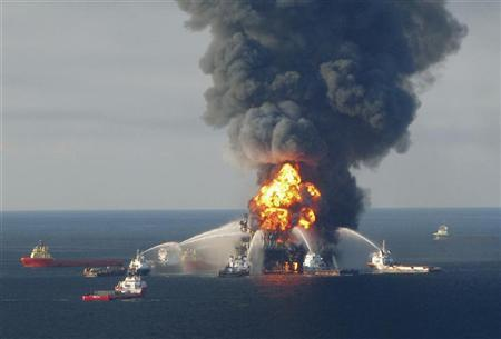 Fire boat response crews battle the blazing remnants of the offshore oil rig Deepwater Horizon, off Louisiana, in this April 21, 2010 file handout image. REUTERS/U.S. Coast Guard/Files/Handout
