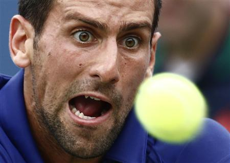 Novak Djokovic of Serbia hits a return to Stanislas Wawrinka of Switzerland during their men's singles match at the U.S. Open tennis tournament in New York September 5, 2012. REUTERS/Eduardo Munoz