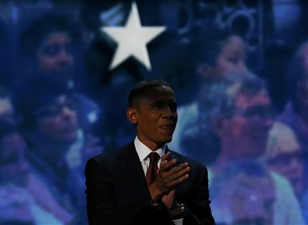 U.S. President Barack Obama waits before joining former President Bill Clinton on stage during the second session of the Democratic National Convention in Charlotte, North Carolina, September 5, 2012. REUTERS/Jim Young