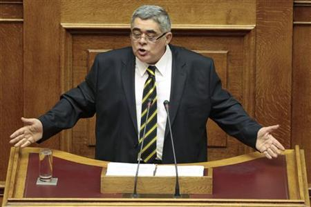 Leader of the extreme right Golden Dawn party Nikolaos Mihaloliakos addresses parliamentarians during a session at the parliament in Athens July 7, 2012. REUTERS/Yorgos Karahalis
