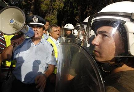 A Greek police officer shouts slogans outside a riot police facility in Athens September 6, 2012. REUTERS/John Kolesidis