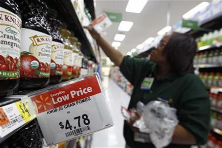 A Walmart employee stocks shelves in a newly opened Walmart Neighborhood Market in Chicago, September 21, 2011. REUTERS/Jim Young