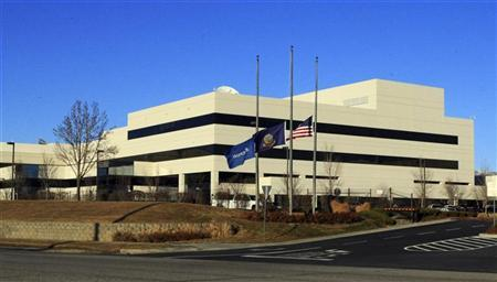 Flags fly at half-staff at the main entrance to Micron corporate headquarters in Boise, Idaho, February 3, 2012. REUTERS/Brian Losness