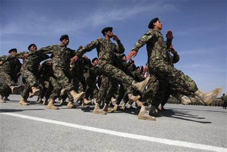 Afghan National Army soldiers march during the graduation ceremony which marks the completion of nine weeks of training at the Kabul Military Training Center (KMTC) in Kabul May 10, 2012. REUTERS/Omar Sobhani