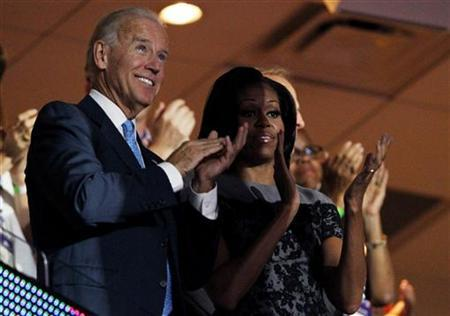 U.S. Vice President Joe Biden (L) and first lady Michelle Obama (R) applaud as they watch from the first lady's box during the second session of the Democratic National Convention in Charlotte, North Carolina, September 5, 2012. REUTERS/Jonathan Ernst