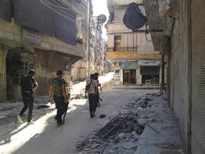 Members of the Free Syrian Army walk through a neighbourhood in Aleppo September 2, 2012. Picture taken September 2, 2012. REUTERS/Shaam News Network/Handout