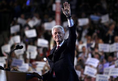 Former U.S. President Bill Clinton waves as he arrives to address the second session of the Democratic National Convention in Charlotte, North Carolina, September 5, 2012. REUTERS/Jessica Rinaldi