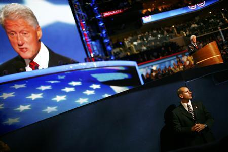 Former U.S. President Bill Clinton is pictured on a large screen as he addresses the second session of the Democratic National Convention in Charlotte, North Carolina September 5, 2012. REUTERS/Eric Thayer