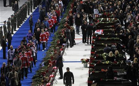 People gather at Arena-2000, home venue of ice hockey team Lokomotiv Yaroslavl, as they pay their last respects to the victims of Wednesday's plane crash, in Yaroslavl September 10, 2011. The Lokomotiv team were on route to play their KHL season opener in the Belarus capital of Minsk when their Yak-42 aircraft crashed into a river bank shortly after takeoff from the airport outside Yaroslavl, 250 km (150 miles) north of Moscow, killing 43 people. REUTERS/Denis Sinyakov
