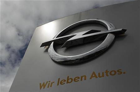The logo German car manufacturer Opel with its promotional slogan '' We live cars'' is pictured at the headquarters in Ruesselsheim July 17, 2012. REUTERS/Alex Domanski