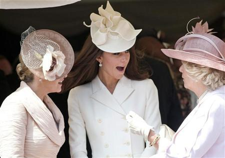 Britain's Catherine, Duchess of Cambridge (C), Camilla, Duchess of Cornwall (R) and Sophie, Countess of Wessex (L) attend the annual Order of the Garter Service at St George's Chapel at Windsor Castle in Windsor, southern England, June 18, 2012. REUTERS/Paul Edwards/Pool