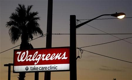A sign for a Walgreens store is seen in Belle Glade, Florida January 6, 2010. REUTERS/Carlos Barria