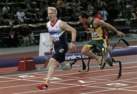 Britain's Jonnie Peacock wins the Men's 100m - T44race in the Olympic Stadium during the London 2012 Paralympic Games September 6, 2012. In the T44 class competition athletes compete with a single leg amputation below the knee. REUTERS/Luke MacGregor