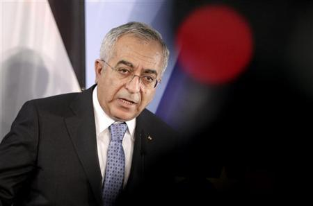 Palestinian Prime Minister Salam Fayyad addresses a news conference after talks with Germany's Foreign Minister Guido Westerwelle in Berlin March 28, 2012. REUTERS/Tobias Schwarz