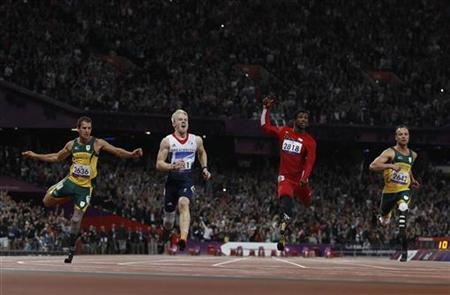 Britain's Jonnie Peacock (2nd L) wins the men's 100m T-44 final ahead of South Africa's Amu Fourie (L), Richard Browne of the U.S. (2nd R) and South Africa's Oscar Pistorius in the Olympic Stadium at the London 2012 Paralympic Games September 6, 2012. REUTERS/Suzanne Plunkett