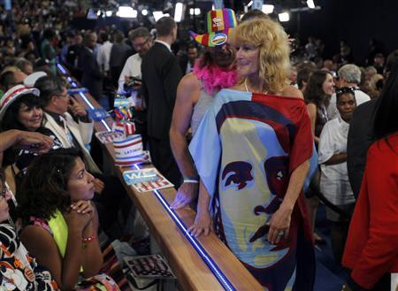 A delegate wears a dress bearing the likeness of U.S. President Barack Obama during the final session of the Democratic National Convention in Charlotte, North Carolina September 6, 2012. REUTERS/Jessica Rinaldi