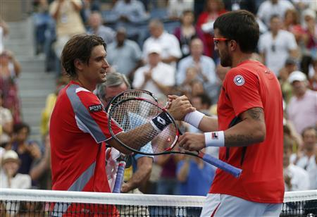 David Ferrer of Spain is congratulated by Janko Tipsarevic (R) of Serbia after their men's singles quarterfinals match at the U.S. Open tennis tournament in New York September 6, 2012. REUTERS/Mike Segar