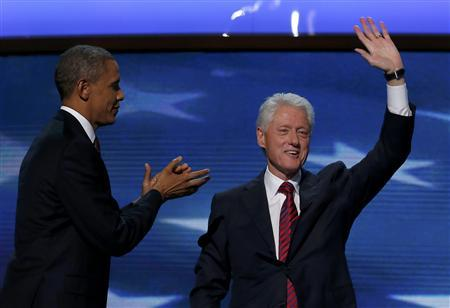 U.S. President Barack Obama (L) joins former U.S. President Bill Clinton onstage after Clinton nominated Obama for re-election during the second session of the Democratic National Convention in Charlotte, North Carolina, September 5, 2012. REUTERS/Jim Young