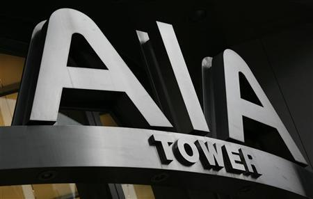 The logo of AIA Tower is seen at its entrance in Hong Kong June 3, 2010. REUTERS/Bobby Yip