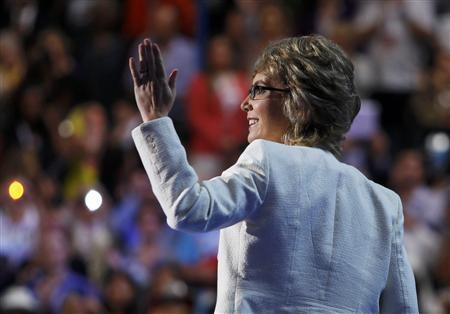 Former Congresswoman Gabrielle Giffords waves after Giffords led the convention in the U.S. Pledge of Allegiance during the final session of the Democratic National Convention in Charlotte, North Carolina September 6, 2012. REUTERS/Jessica Rinaldi