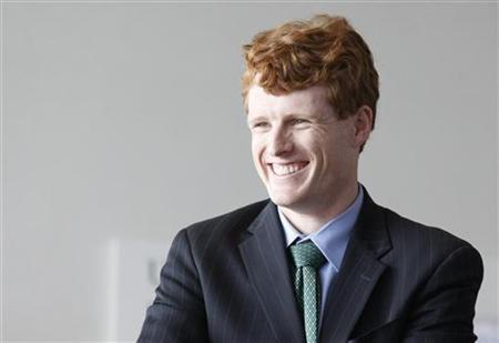 Massachusetts Congressional candidate Joseph Kennedy III laughs as he waits for Prime Minister of Ireland Enda Kenny to arrive at the John F. Kennedy Presidential Library and Museum in Boston, Massachusetts February 17, 2012. REUTERS/Jessica Rinaldi