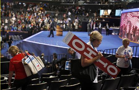 Ohio delegate Kathy Rollison carries the Ohio sign after adjournment of the final session of the Democratic National Convention in Charlotte, North Carolina September 6, 2012. REUTERS/Jessica Rinaldi
