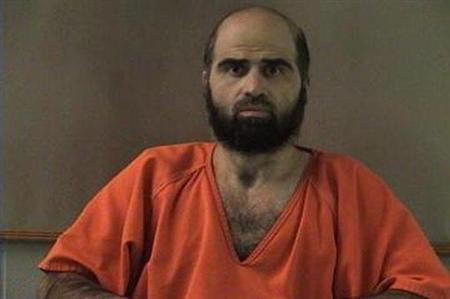 Nidal Hasan, charged with killing 13 people and wounding 31 in a November 2009 shooting spree at Fort Hood, is pictured in an undated handout photo obtained by Reuters June 29, 2012. REUTERS/Bell County Sheriff's Office/Handout