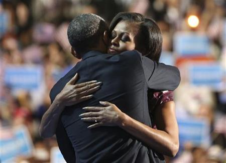 U.S. President Barack Obama and first lady Michelle Obama hug on stage during the final session of the Democratic National Convention in Charlotte, North Carolina September 6, 2012. REUTERS/Philip Scott Andrews