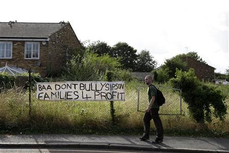A banner protesting against a third runway is seen in the village of Sipson near Heathrow Airport in west London August 28, 2012. REUTERS/Stefan Wermuth