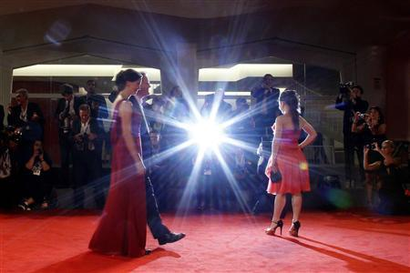 Directors Jessica Woodworth (L), Peter Brosen and actress Aurelia Poirier (R) pose on the red carpet during a screening for the movie ''La cinquieme Saison'' at the 69th Venice Film Festival September 6, 2012. REUTERS/Tony Gentile