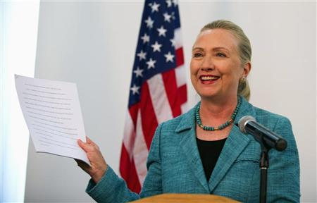 U.S. Secretary of State Hillary Clinton holds up papers as she refers to the ''As Prepared'' version of former U.S. President Bill Clinton's Democratic National Convention speech that she had read, during a joint news conference with East Timor's Prime Minister Xanana Gusmao (not pictured) at the Government Palace in Dili, East Timor, September 6, 2012. REUTERS/Jim Watson/Pool