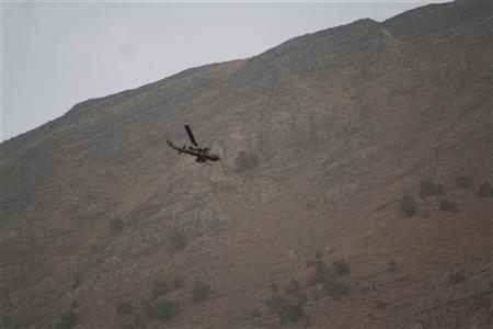 A Turkish military helicopter flies over the border of an area between Iraq and Turkey during a military operation against PKK Kurdish militants October 25, 2011. Picture taken October 25, 2011. REUTERS/Stringer