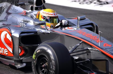 McLaren Formula One driver Lewis Hamilton of Britain steers his car during the first practice session of the Italian F1 Grand Prix at the Monza circuit September 7, 2012. REUTERS/Giorgio Perottino