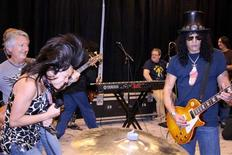 Guitarist Slash (R) performs with attendees at the Rock 'n' Roll Fantasy Camp in Las Vegas, Nevada in this 2007 publicity photo released to Reuters September 5, 2012. REUTERS/Rock'n'Roll Fantasy Camp/Handout