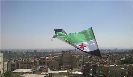 An opposition flag is seen over neighborhood Ruknuddin in Damascus August 5, 2012. REUTERS/Shaam News Network/Handout