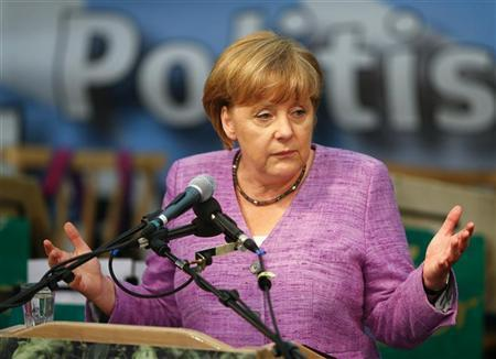 German Chancellor Angela Merkel gives a speech in a beer tent at the traditional folk festival 'Gillamoos' in Abensberg, southern Germany, September 3, 2012. REUTERS/Michael Dalder
