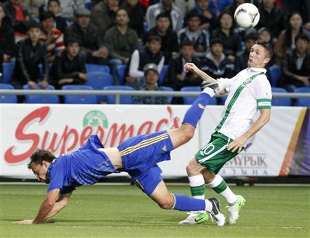 Kazakhstan's Mikhail Rozhkov (L) struggles for the ball with Ireland's Robbie Keane during their World Cup 2014 qualifying soccer match in Astana September 7, 2012. REUTERS/Shamil Zhumatov