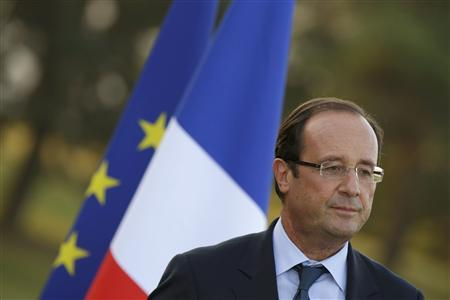 France's President Francois Hollande gives his speech during his visit to the Evian water bottling plant in Evian, September 7, 2012. REUTERS/Philippe Wojazer