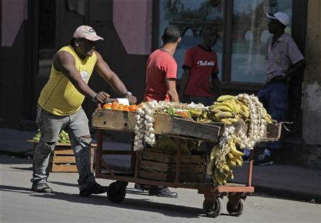 A man with a private license to sell vegetables pushes his cart on a street in Havana February 29, 2012. REUTERS/Enrique de la Osa